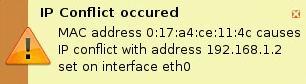 An IP Address Conflict GUI dialog triggered by IPwatchD Daemon